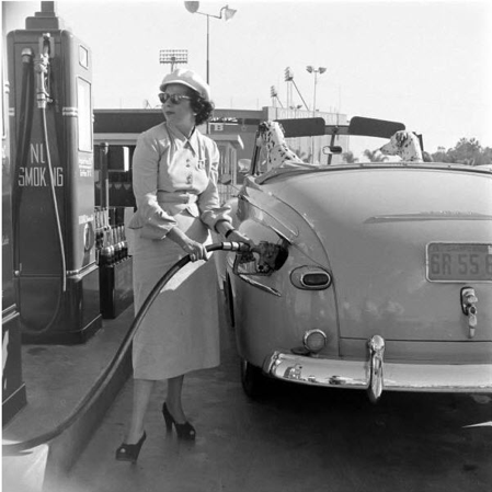 woman pumping own gas 1960s